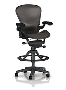The tall chair is an ergonomic seating alternative for a work surface fixed for standing postures.
